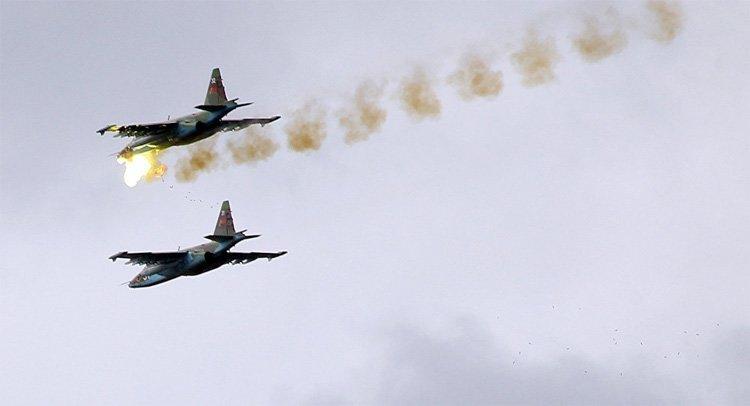Russiske fly ødelegger IS-baser, heter det i teksten til dette bildet fra Sputniknews