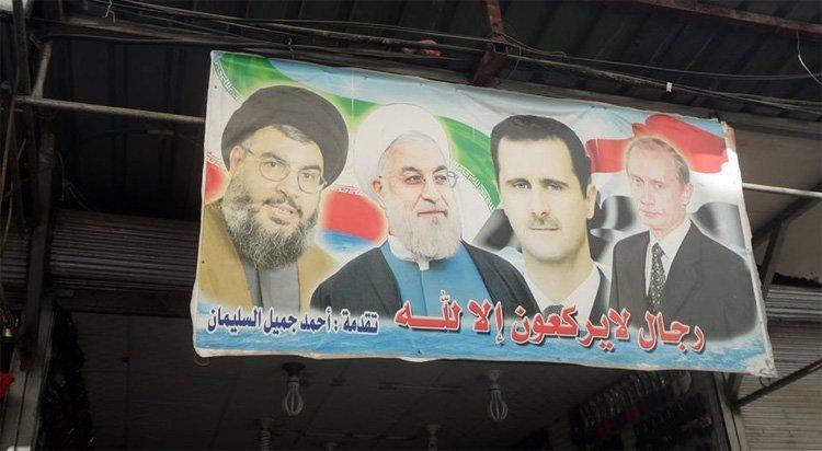 Denne plakaten hang mange steder i Damaskus
