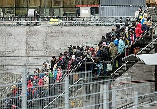 Flyktninger ankommer Malmö. Foto: TT